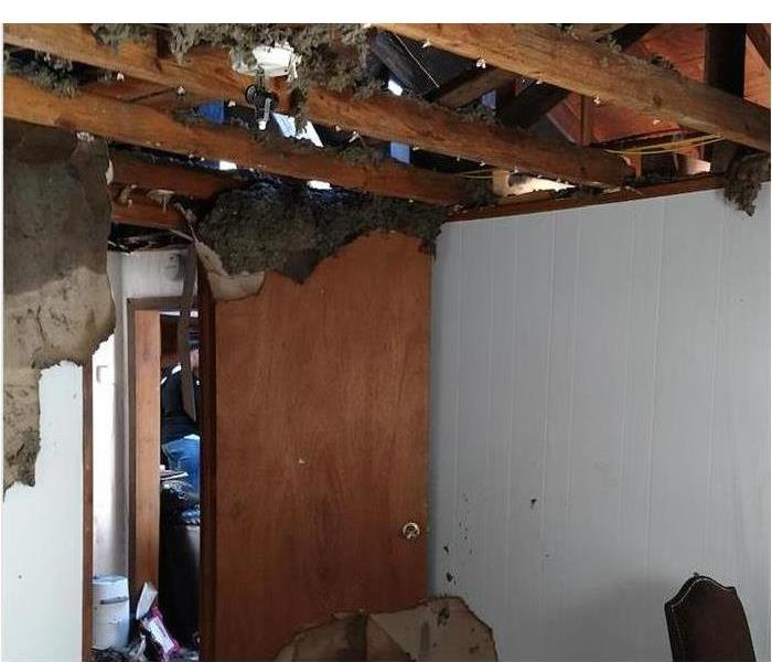 Ceiling collapsed after storm.